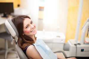 a woman is glad she wondered how to find an orthodontist